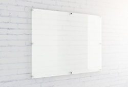 Blank glass plate on white brick wall background. Mock up, 3D Rendering